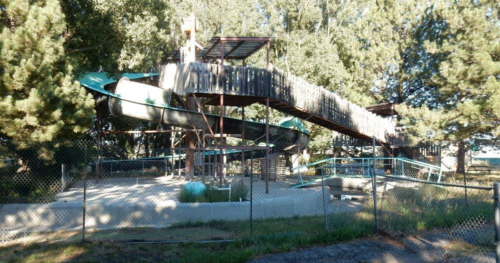 Next door is an abandoned water park. It's fenced off but visible from the park.