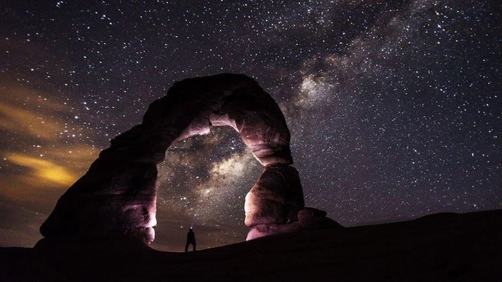 Where we were, the stone were only silhouettes in the distance. This is the iconic delicate arch.