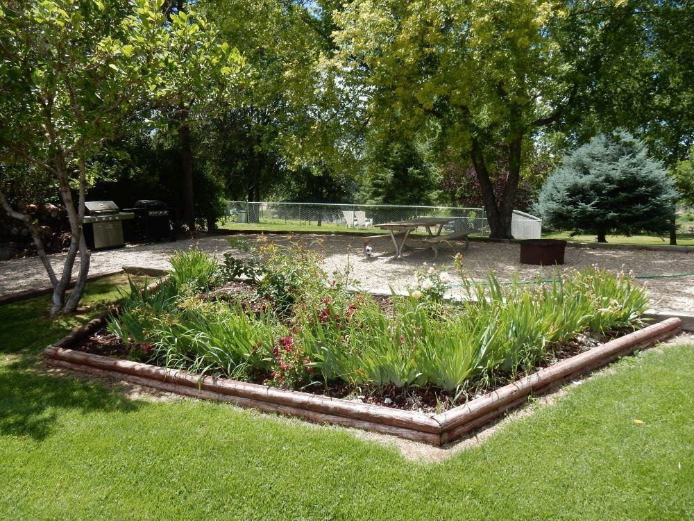 This picnic area is typical of the site, a nice mix of garden, lawn and trees.