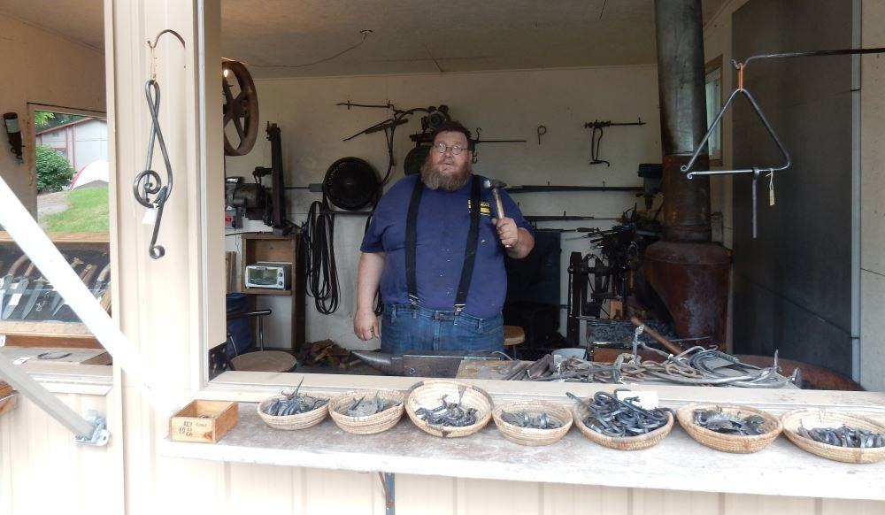 This is the on-site blacksmith, owner of Iron Grip Blacksmithing. I chatted him up for a couple of hours.