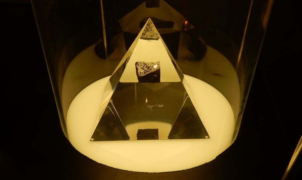 A moon rock encased in a glass pyramid. One of many artifacts at the museum.